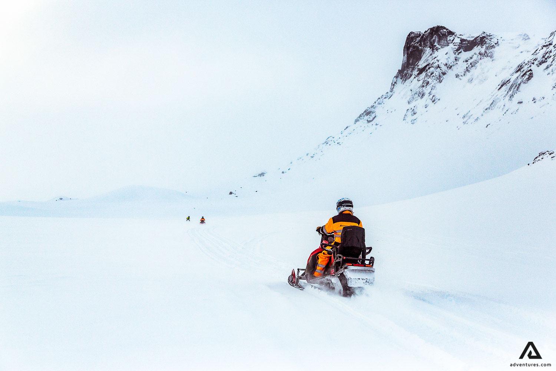 Man riding snowmobile