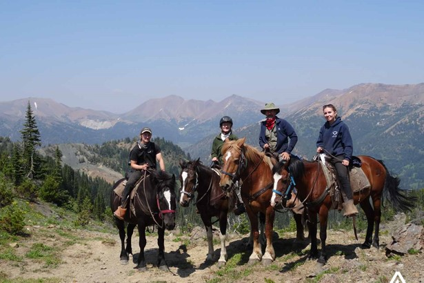A group of people on a horse ride tour