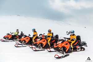 On an exciting snowmobiling tour on Langjokull glacier