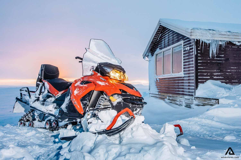 Orange snowmobile on snow