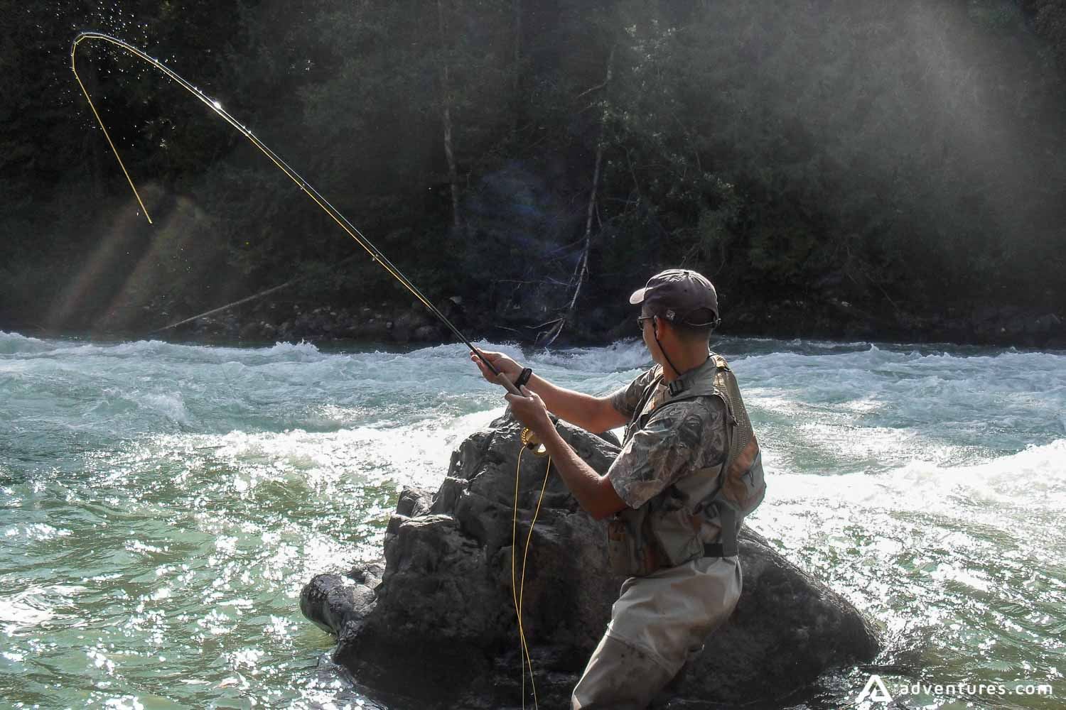 Man fishing in blue ribbon river