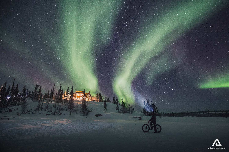 Biking under the Northern lights