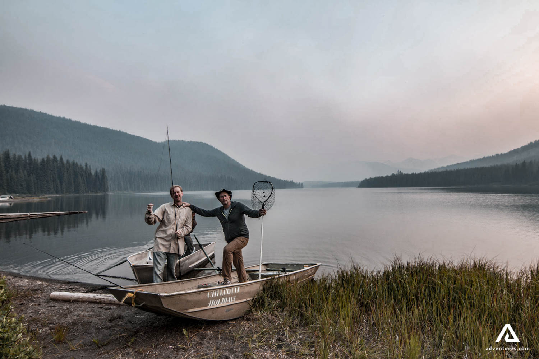 Men standing in fishing boat