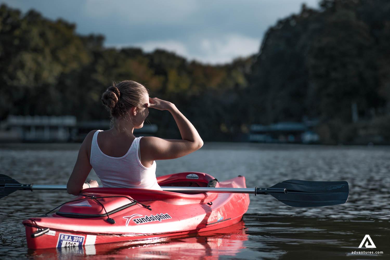 Girl in red kayak