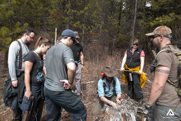 Tourists learning bushcrafting in Canada