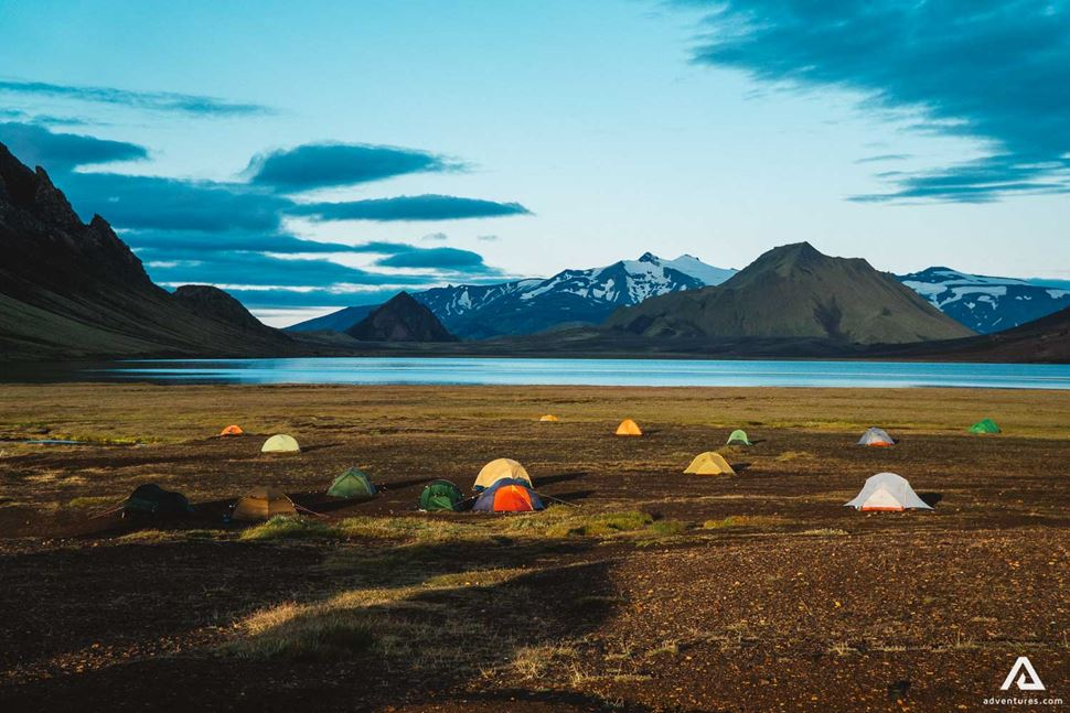 Camping Place In Iceland With Tents By The Lake