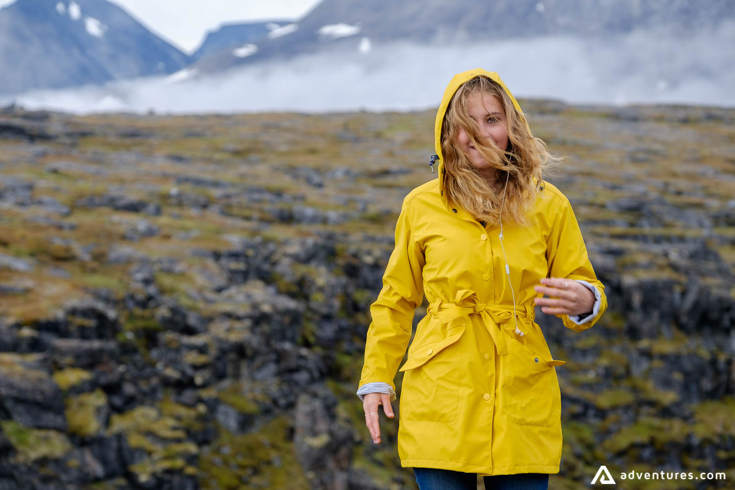 Girl with yellow jacket with a mountain view