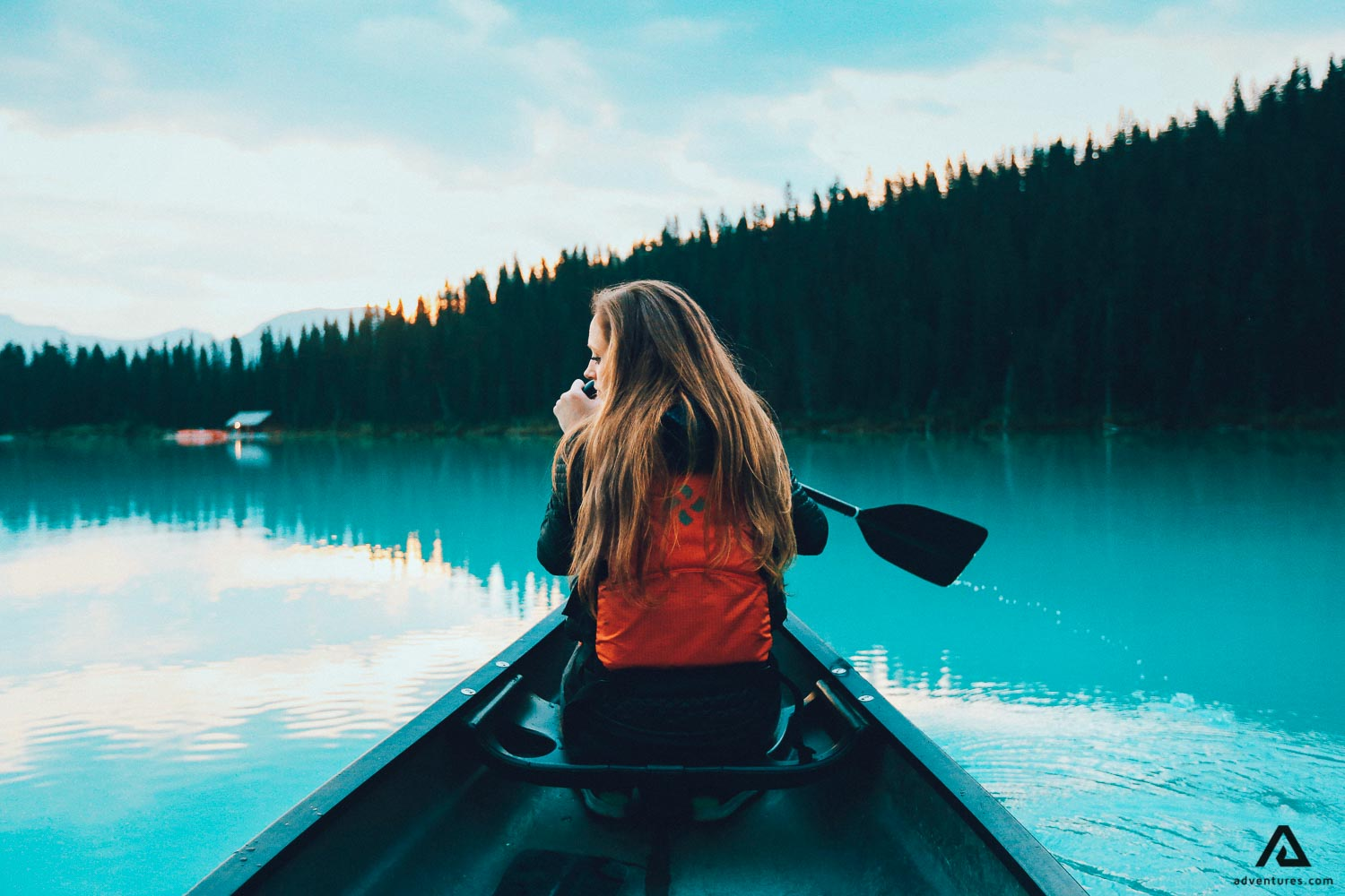 Girl canoeing on the lake in Canada