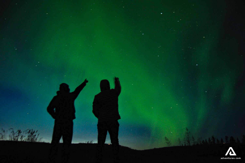 Men enjoying Aurora Borealis