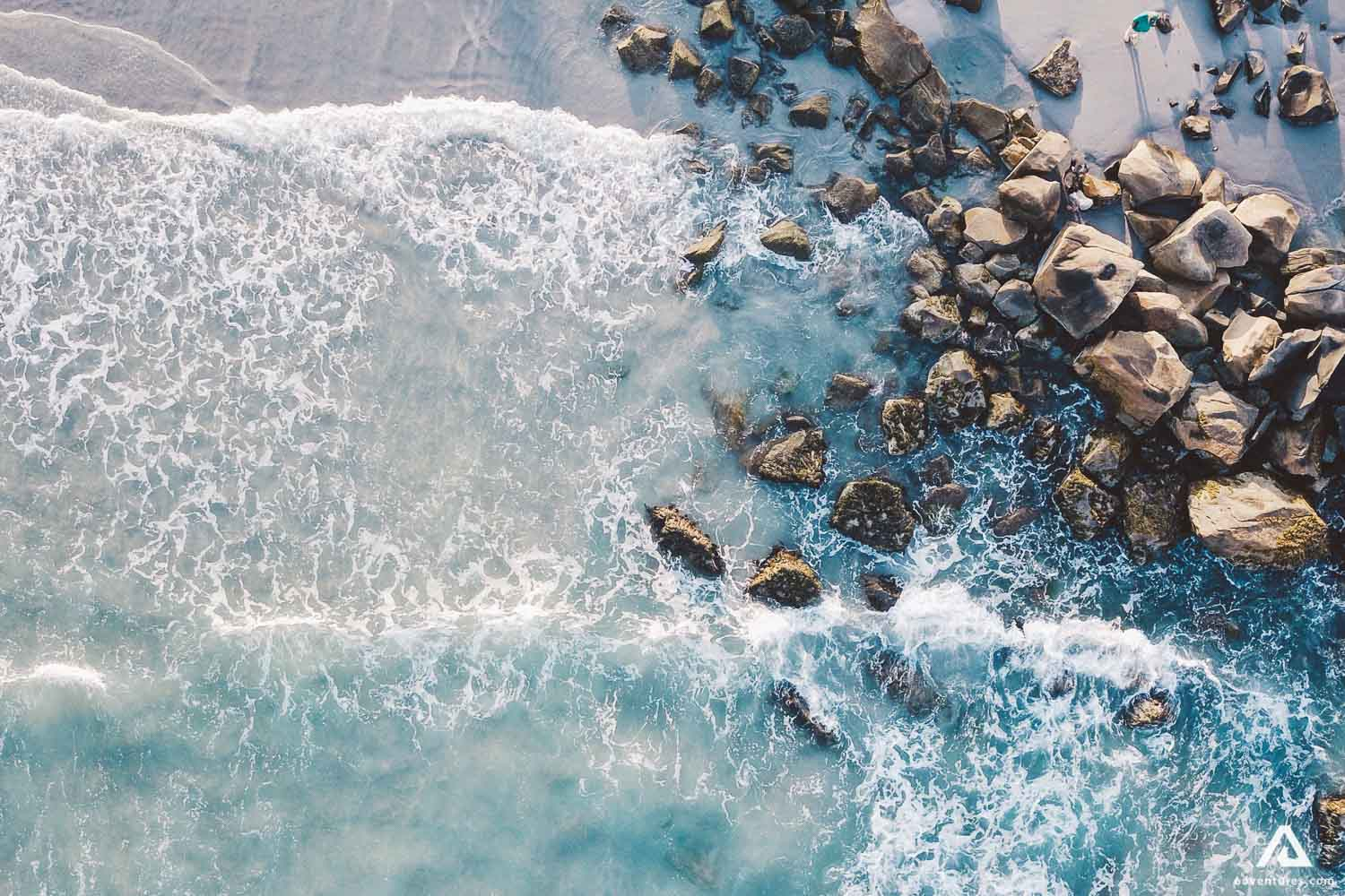 Small stones on the beach from a bird eye view