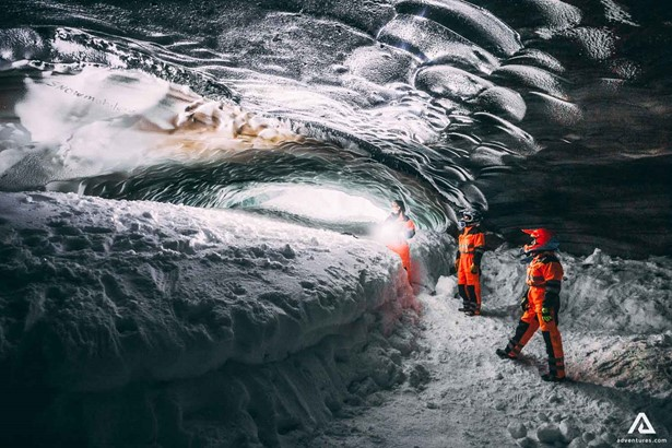 Exploring Ice Cave on Smowmobile tour