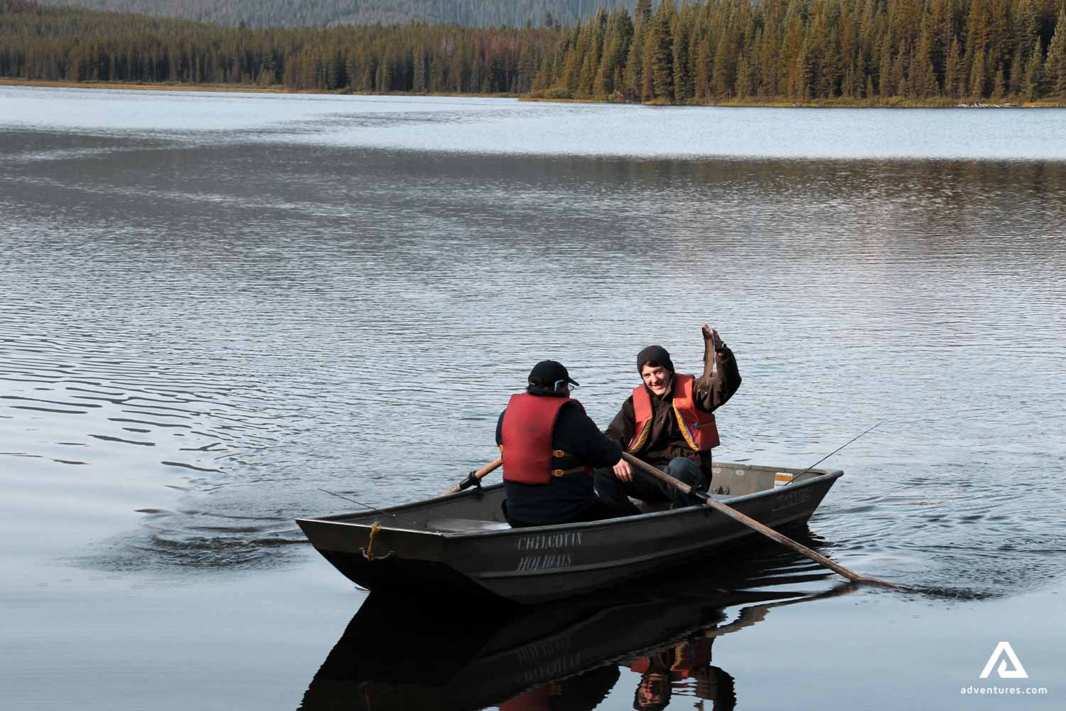 Two mid-age men fishing from a boat