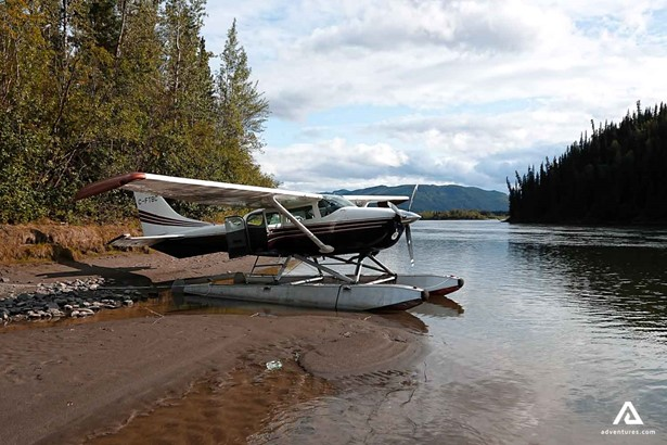 Bushplane landed on the shore of a river