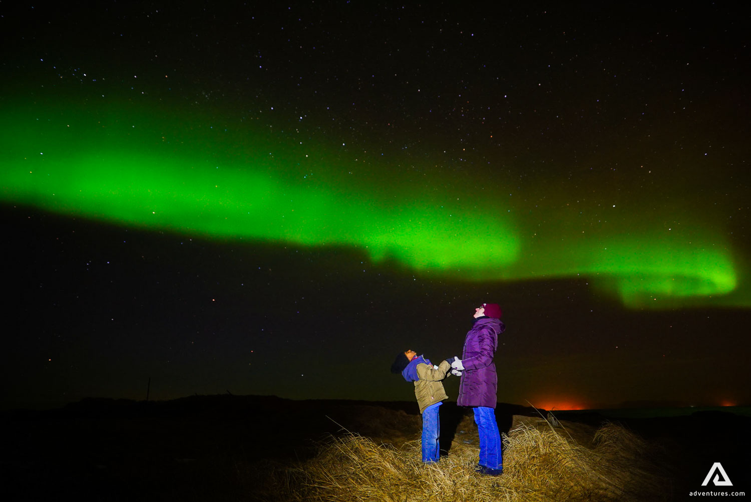 Mother and son watching Northern Lights