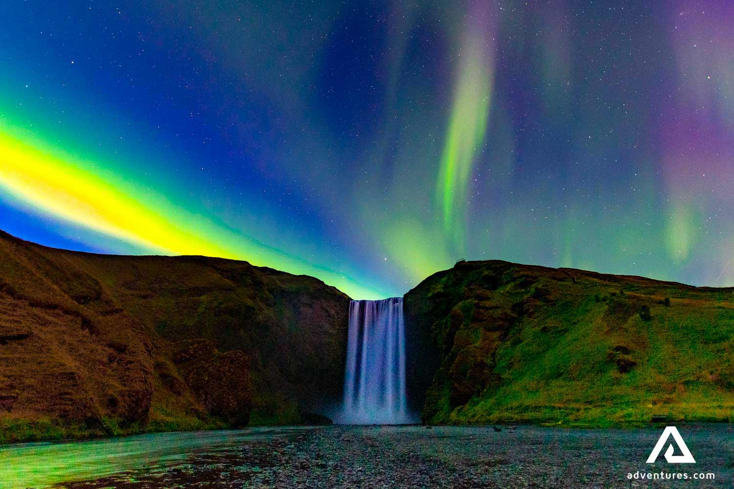 Northern Lights over Skógafoss waterfall in south Iceland