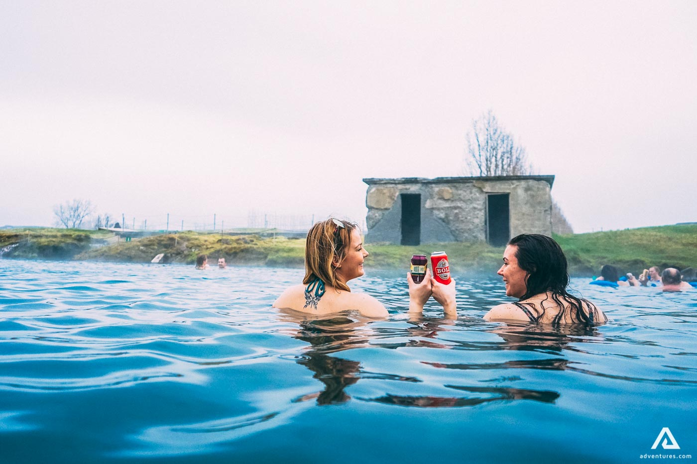 Women bathing on Secret Lagoon