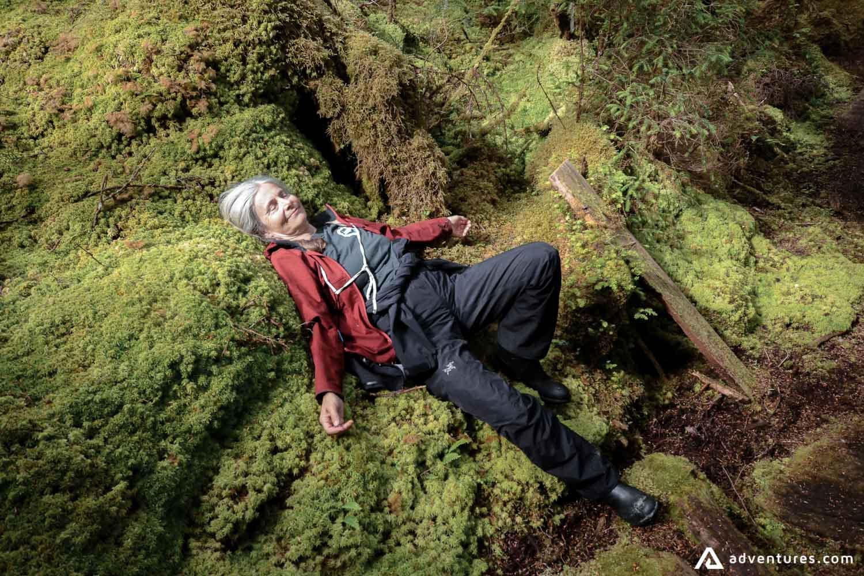 Woman laying on a moss