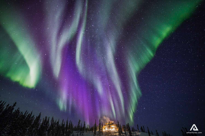 Purple green aurora borealis