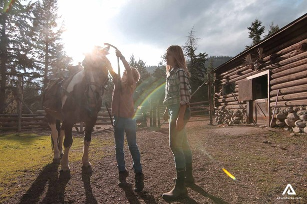 Preparing for horseback riding in a ranch