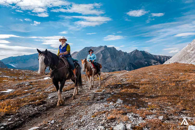 Happy tourists on a horseback tour