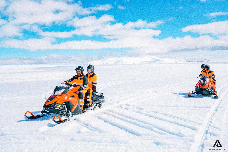 Tourists on a snowmobile tour