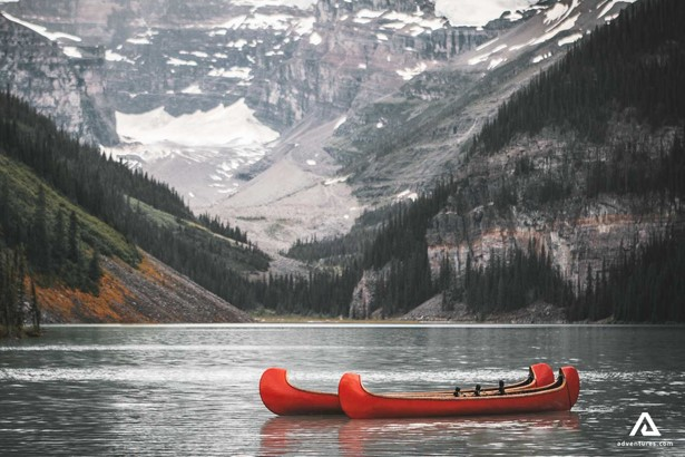 Canoes on the Lake with the Mountain view