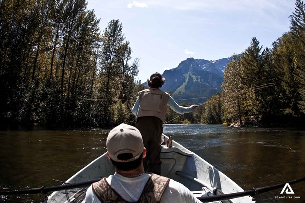 Fly fishing from the boat in forest river