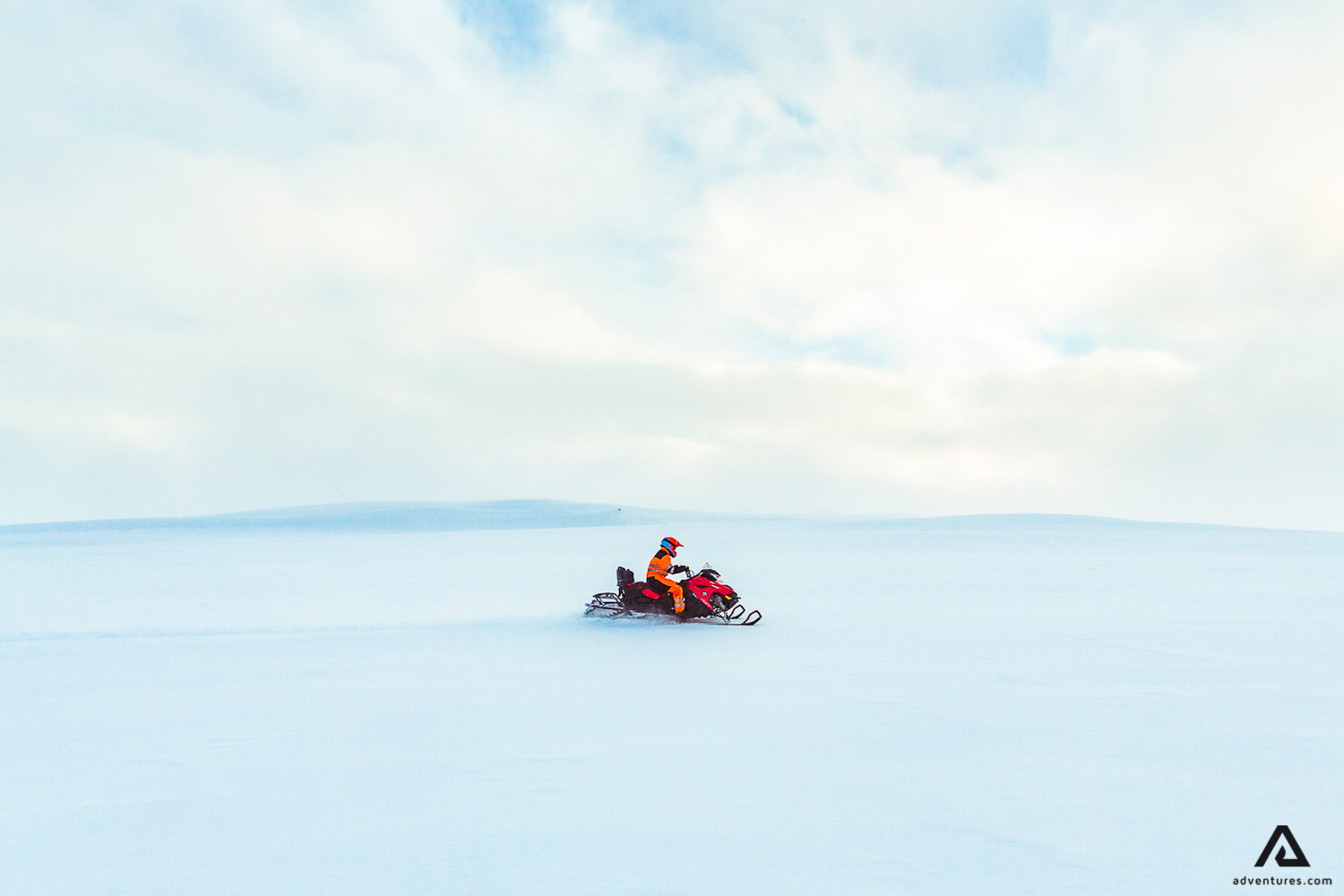 Riding snowmobile in Iceland