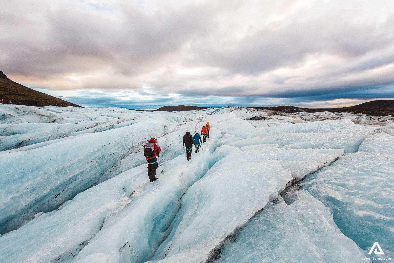 People walking on glacier