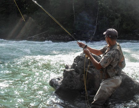 Fly-fishing for trout on Blue Ribbon rivers from this lodge