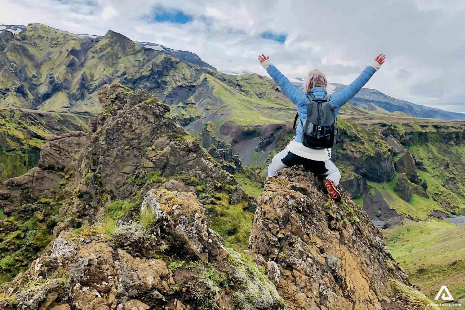 Hiker woman with raised hands in Thorsmork