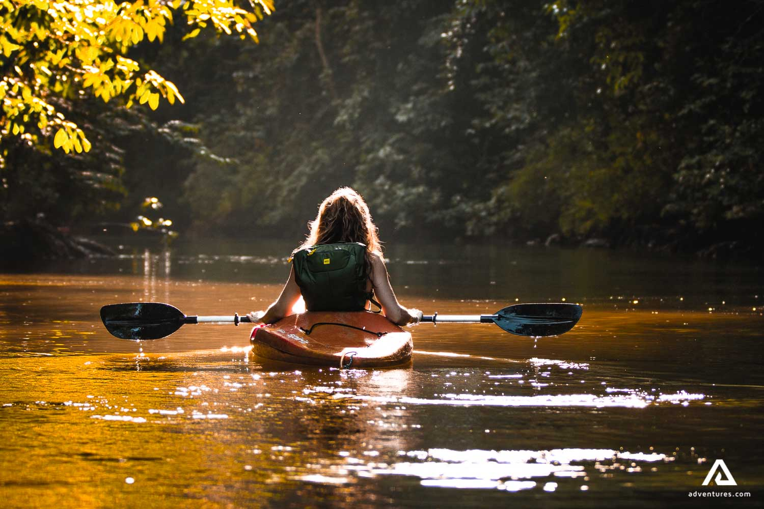 Woman kayaking in the river