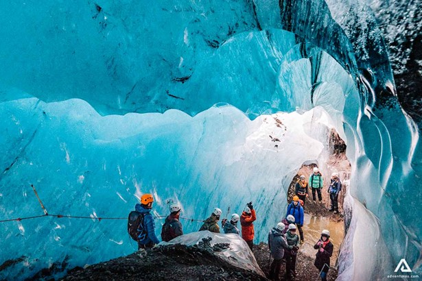 Group of tourists in the ice cave