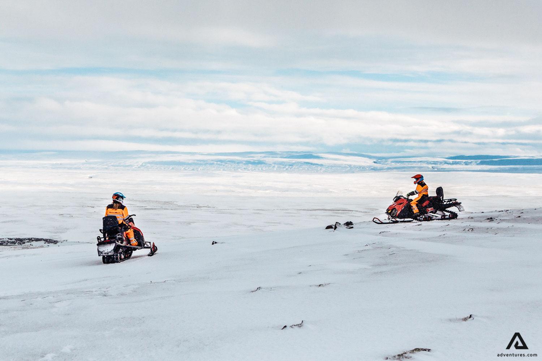 Riding snowmobile