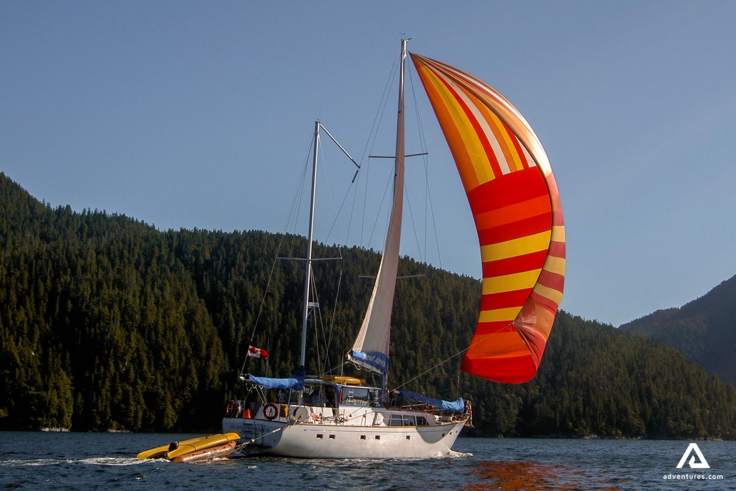 Sailing boat with a colorful sail