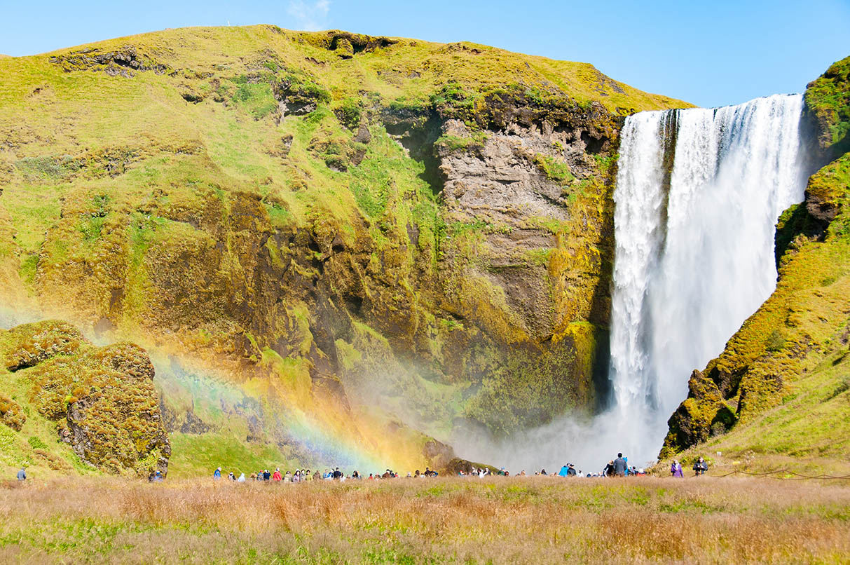 Skógafoss in summer with its rainbow