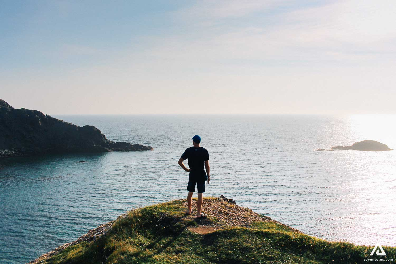Man on the edge of the cliff near Labrador Sea
