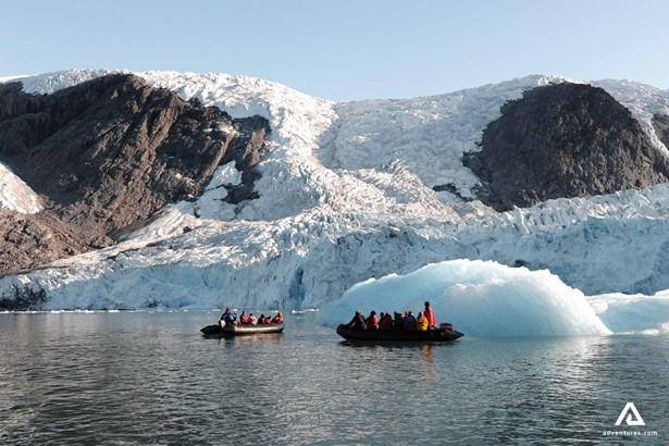 Exploring Greenland coast by a boat