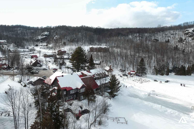 Winter cottage village aerial view