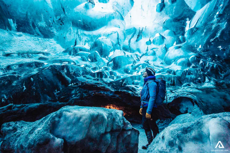 Man enjoying Vatnajokull blue ice cave