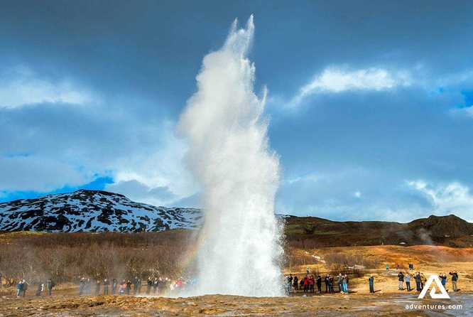The Strokkur Geysir is gushing up to the sky in the Golden Circle of Iceland