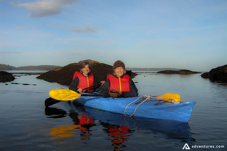 Happy women on a canoe