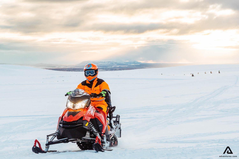 Man driving snowmobile