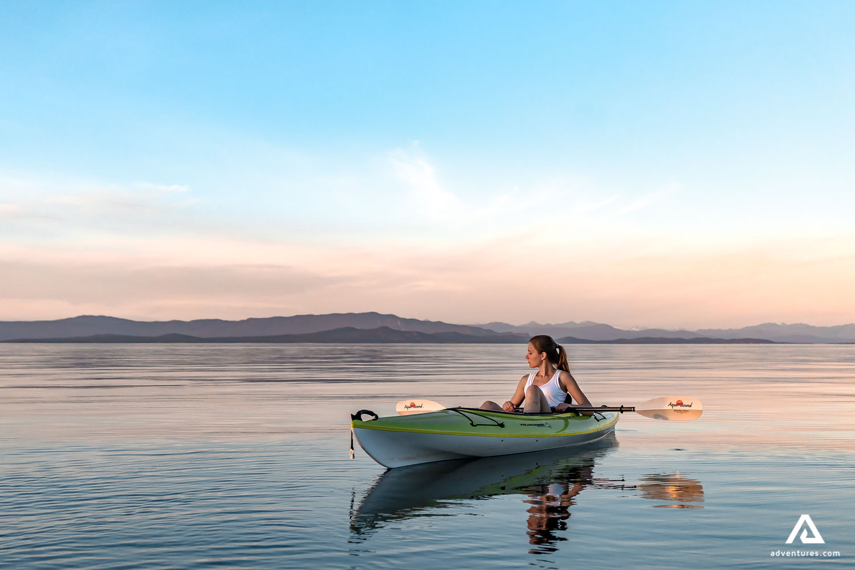 Girl in green kayak