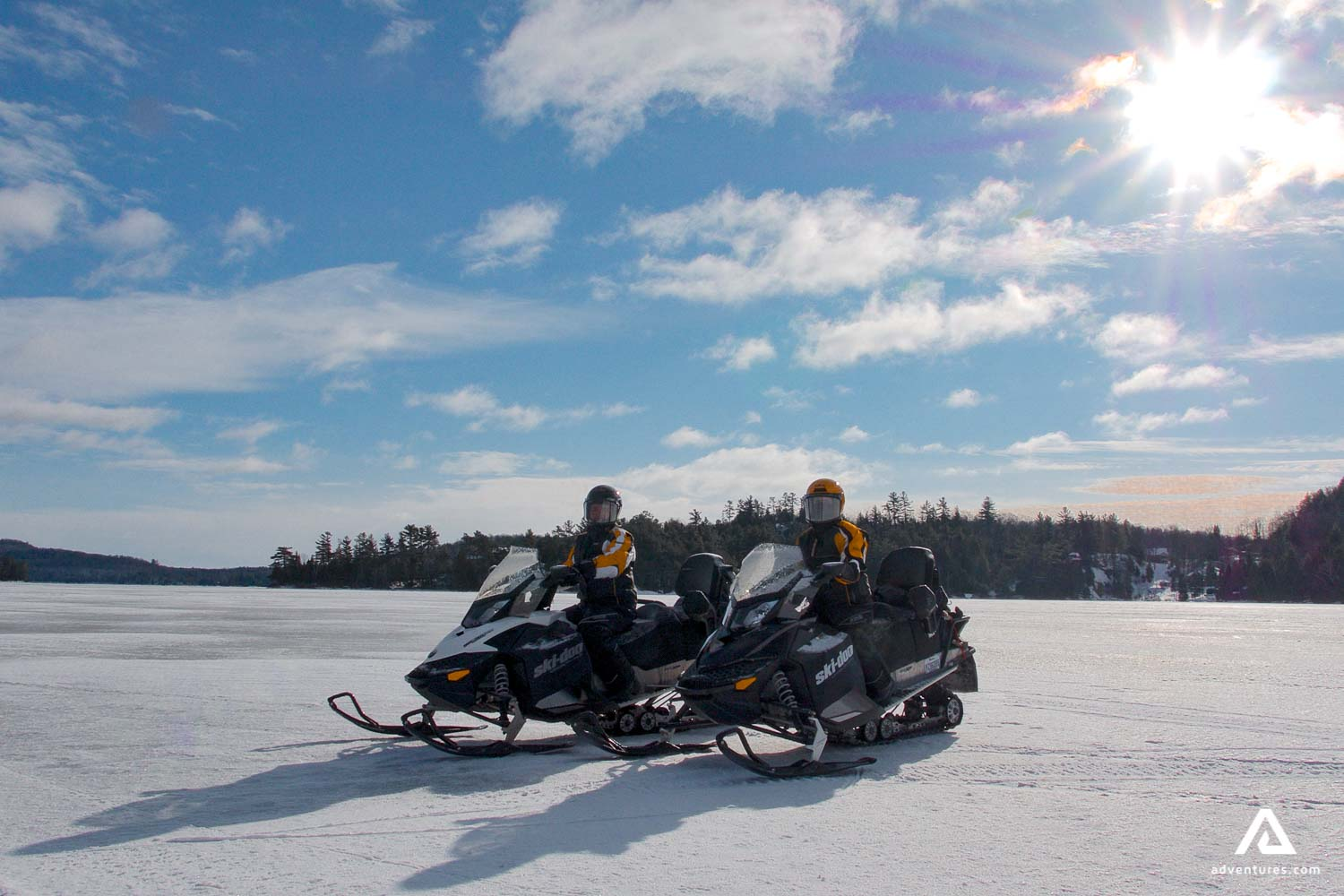 Snowmobiling in the sunny day