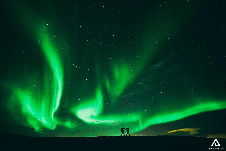 Couple enjoying Northern Lights