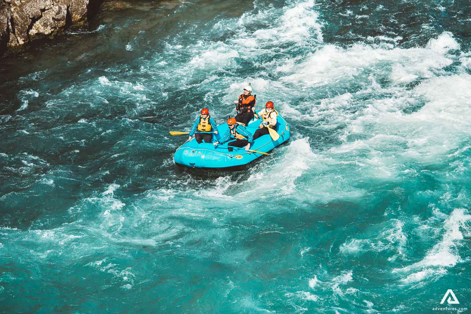 Four People Are Rafting On The River