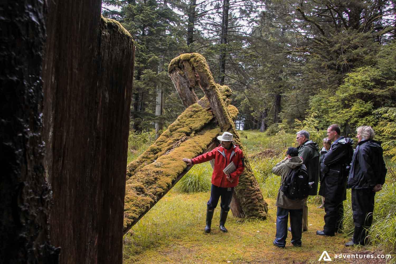 Tourists exploring ancient Haida villages