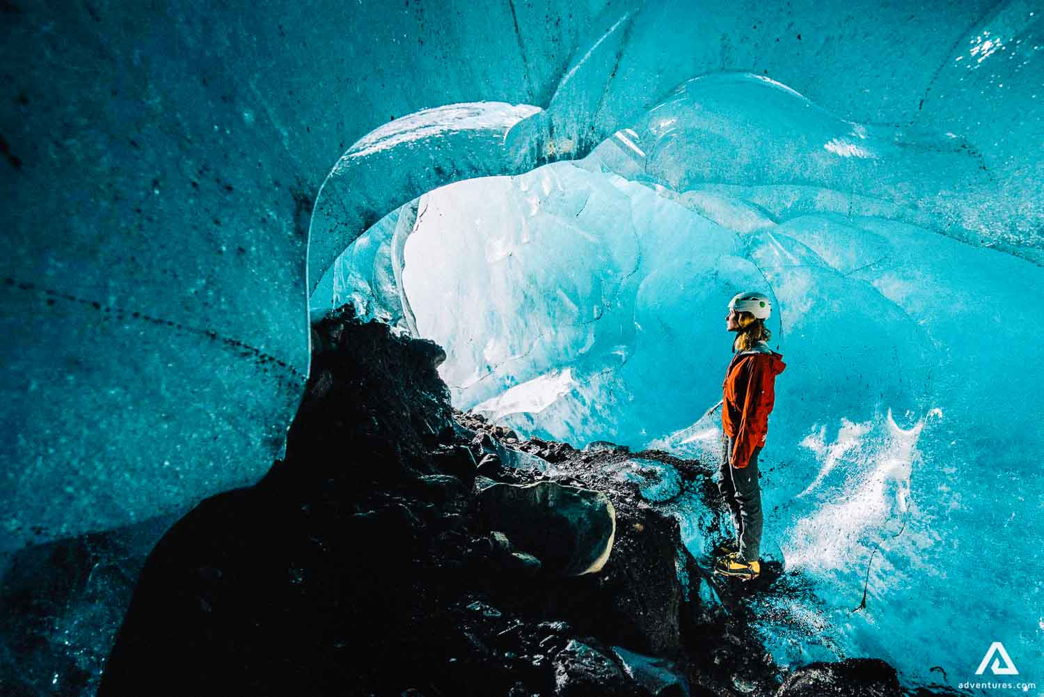 Girl exploring Into The Glacier ice cave