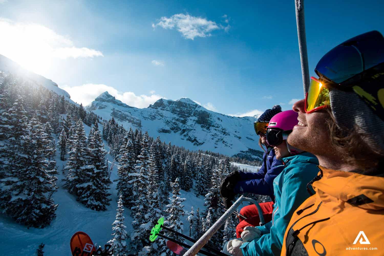 Happy people on a ski lift